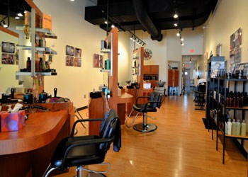 Interior of men's hair salon in Bethlehem, PA with hair stylist stations and hair products