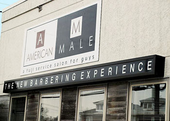 outside storefront of american male reading pa barber shop